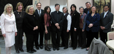 Fr. Frank and Jim Pinto with Promise Makers at a Joy-filled Reception: