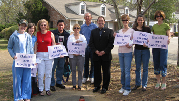 Jim gathers with some of the Pro-Life faithful and their signs for life
