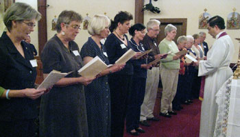 Fr. Frank receives the permanent promises of these Missionaries of the Gospel of Life.
