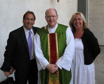 Jim and Joy Pinto with Msgr. Farmer in front of the historic Cathedral Basilica of the Immaculate Conception, Archdiocese of Mobile.