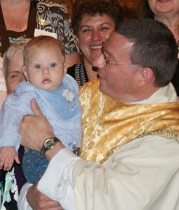 Fr. Paul Schenck with little Ben.