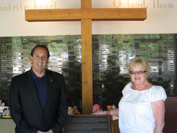 "Jim Pinto and Carol Martin, Office Manager-National Memorial for the Unborn, before the Cross and Wall of Names memorializing the unborn.  ""The Memorial features a fifty foot granite ""Wall of Names"" which holds small brass plates with words of remembrance placed by mothers, fathers and other family members from all over the country."""