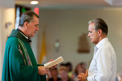 Fr. West receives the promises of Edward Gebar as a Lay Missionary of the Gospel of Life