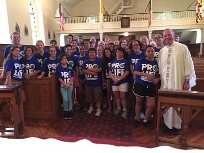 Fr Wilde with returning and fresh crop of Defend Life MD assembled after Mass at historic Sacred Heart Church in Bowie MD during the 2015 Maryland Face the Truth Tour.