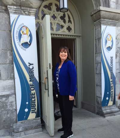 Janet walks through the Holy Door at the Notre Dame Cathedral Basilica of Ottawa