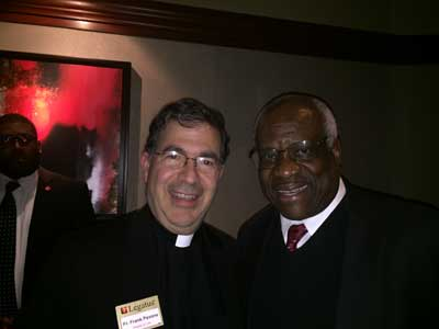 Fr Frank with Supreme Court Justice Clarence Thomas at a dinner event.