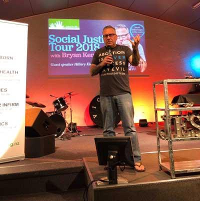 Bryan Kemper speaking in Wellington, New Zealand