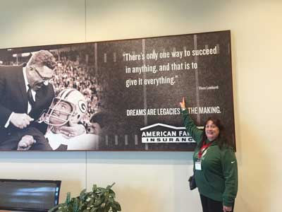 Janet Morana points to an inspirational quote by legendary Packers coach Vince Lombardi.