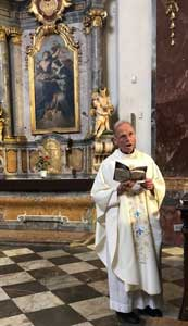 Fr.Denis offering Holy Mass at Church of Maria Victoria where the original Infant of Prague is located.
