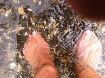 Feet washing in Sea of Galilee