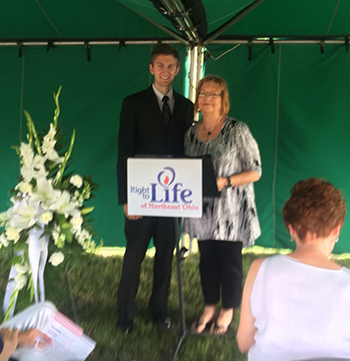 Christy with Andrew Kustec, President of Students for Life at the University of Akron at the Akron, OH memorial.