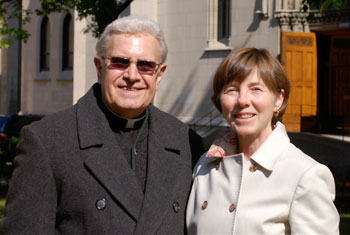 GAIL CAMPBELL with Fr. Breier, her Pastor; the Cathedral is in the background.