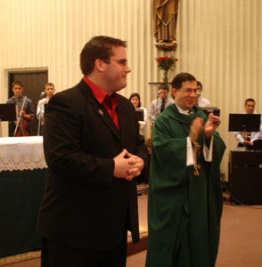 Fr. Frank and congregation applaud Justin after he makes his promises as a Missionary of the Gospel of Life
