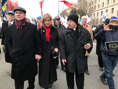 Fr. Frank Pavone with March for Life President, Jeanne Mancini and her husband.