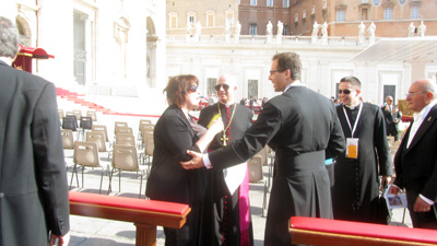 Janet being told that she will be able to greet the Pope in person.