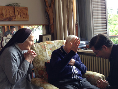 Fr. Frank is blessed by Fr. Giuseppe, St. Gianna