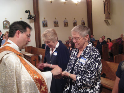 Edith Robus (Right) , Mary Farley and newly professed receive their Missionary of the Gospel of Life Pins as a sign and symbol of their profession and mission.