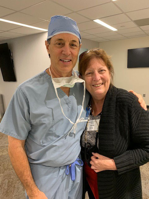 Dr. Kevin Accola, MD, with Janet Morana, executive director of PFL, immediately following Fr Frank's successful surgery.