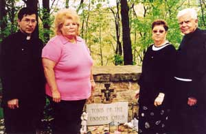<p>Priests for Life mourns passing of Norma McCorvey. Above: Fr. Frank, Sandra Cano, Norma McCorvey and Fr. Scanlan at the Tomb of the Unborn Child in Steubenville</p>