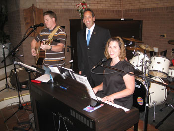 "Jim Pinto with worship leaders, Adam and Lori Ubowski, members of ""Outer Darkness Music."""
