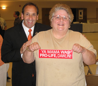 Diane Sorrell with Jim Pinto, presents her Cajun Pro-life Bumper Sticker: YA MAMA, WAS PRO-LIFE, DAWLIN!