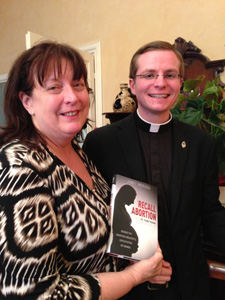 Janet with newly-ordained Fr. Simon Carian, of the Archdiocese of Santa Fe.