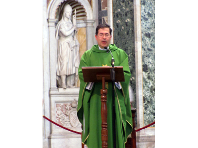 Fr. Frank proclaiming the Gospel in the Basilica of Saint John Lateran, the Pope