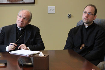 Cardinal Christoph Schönborn (left) watches the monitor closely as we show him our websites