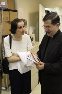 Dr. Gianna Emanuela Molla visits our resource department and receives a signed copy of Fr. Frank's books.