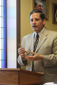 Thomas McKenna shows the fetal stethoscope St. Gianna used in her medical practice