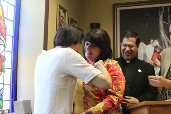 Janet Morana, executive director of Priests for Life, is made an honorary member of the St. Gianna Physician's Guild, which encourages doctors to be actively pro-life. Dr. Gianna Molla of Milan pins Janet