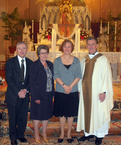 From left to right, Jerry McAfee, Francine Blatz, Genevieve Collins and Fr. Peter West