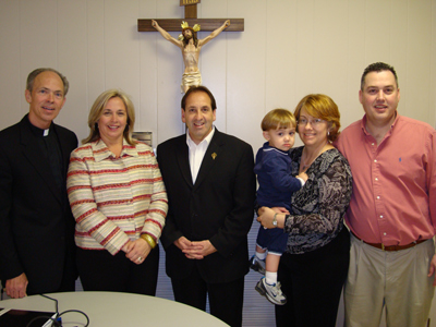 Jim and Joy Pinto with Fr. Deering and Coordinators of the evening Melissa and Rodney Cameron and son, Connor.