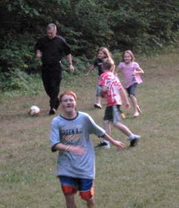 Fr. Peter plays soccer with the kids