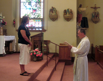 Fr. Peter accepts Sheila's promises as a Missioinary of the Gospel of Life Lay Associate