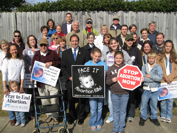 Jim and 40 Days for Life vigil participants of varied ages and Christian traditions gather for a group picture