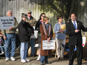 Jim proclaiming the Gospel of Life and the right of assembly near the entry of area abortion mill