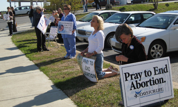 Little Rock 40 Days for Life vigil participants pray across from an abortion mill and witnesses to thousands driving by