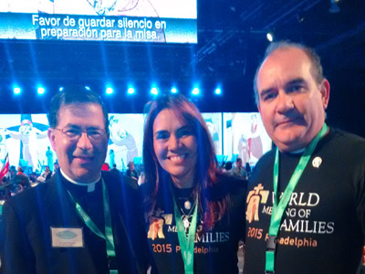 Fr. Frank with a couple from Venezuela