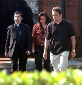 Fr. Frank, with Terri's brother Bobby and sister Suzanne, coming out from Terri's room on the morning that she died.